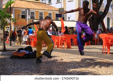 Salvador, Brazil - March 10, 2013 :  Brazilian martial arts Capoeira performed at the street