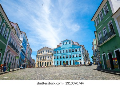 SALVADOR, BRAZIL - MARCH 12, 2015: Pedestrians walk in the wide plaza surrounded by colorful colonial buildings in the historic tourist district of Pelourinho.