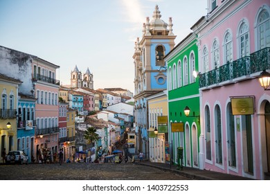SALVADOR, BRAZIL - MARCH, 2018: Street lights dot the colorful colonial architecture as night falls on the cobblestone hills of Pelourinho.
