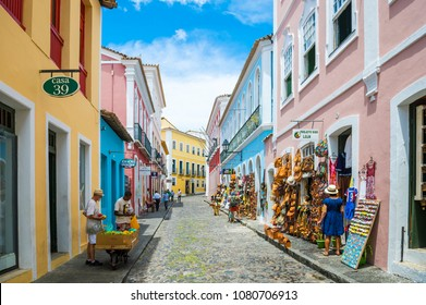 SALVADOR, BRAZIL - MARCH 9, 2017: Souvenir shops selling bags and local handicrafts line the traditional cobblestone streets of the colorful historic tourist district of Pelourinho.