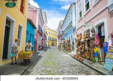 SALVADOR, BRAZIL - MARCH 9, 2017: Souvenir shops selling bags and local handicrafts line the traditional cobblestone streets of the historic tourist district of Pelourinho.