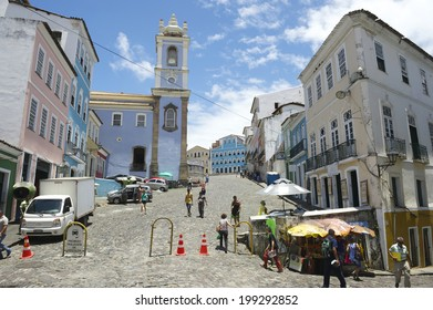 SALVADOR, BRAZIL - OCTOBER 15, 2013: Tourists and locals mix on the cobblestone streets in front of the colonial buildings of Pelourinho, the historic district.