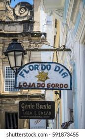 """Salvador, Brazil - October 26, 2016: Colonial style architecture and souvenir shop at the historic """"Pelourinho"""" in Salvador da Bahia"""