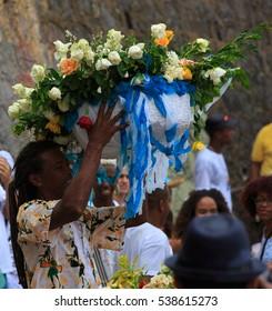SALVADOR - FEBRUARY 2: Iemanja Party, Afro-Brazilian Festival, Man with yellow heat. Rio Vermelho Salvador, February 2, 2016, Brazil.
