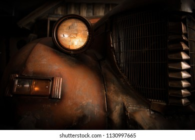 Salvage Title Junk Car. Old and Rusty Classic Car in the Barn. Closeup Photo.