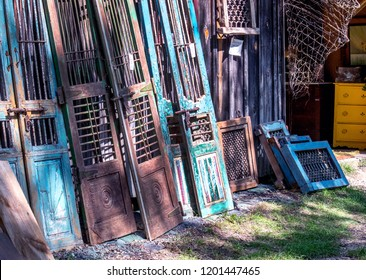 salvage yard with many doors and windows in wood and iron and beautiful detail