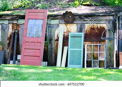 salvage yard with old doors and windows