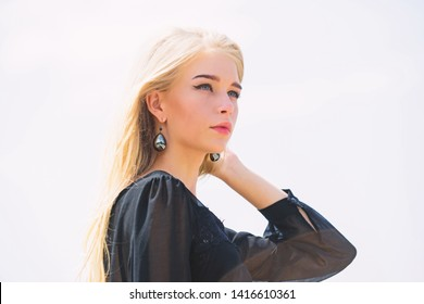 Salvaged my bleached hair. How to take care of bleached hair. Girl tender blonde makeup face sky background. Bleaching roots. How to repair bleached hair fast and safely. Hairdresser tips concept.