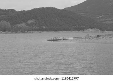 """Salvataggio"" boat (means Rescue boat) isolated in the lake - Fiastra Lake, Marche, Italy"