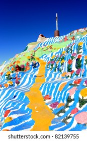Salvation Mountain is a colorful artificial mountain north of Calipatria, California, near Slab City. It is made from adobe, straw, and thousands of gallons of paint.