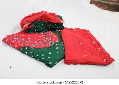 salwar suit on white background  wide range of bandhani, phulkari & other styles of Salwar Suits