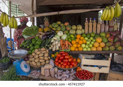 SALY, SENEGAL - MAY 30, 2014: Woman on a fruit and vegetables , on the main road Saly