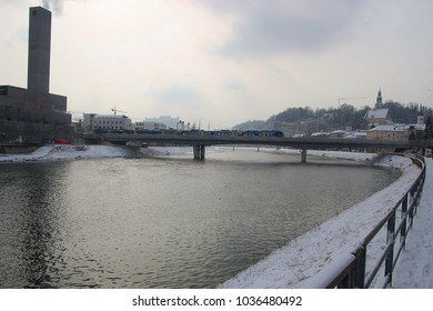 The Salzach river with cogeneration plant in winter. Salzburg city, Austria, Europe. In the background the fortress Hohensalzburg.