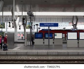 SALZBURG, AUSTRIA 11 September 2017: Train passengers travel to Salzburg Hauptbahnhof, is the main railway station in Salzburg, capital of the federal state of Salzburg, Austria