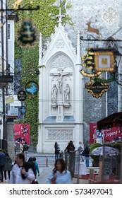SALZBURG, AUSTRIA - APRIL 29, 2016: Shopping street in Salzburg -Getreidegasse with multiple advertising signs. Getreidegasse, is one of the oldest streets in Salzburg