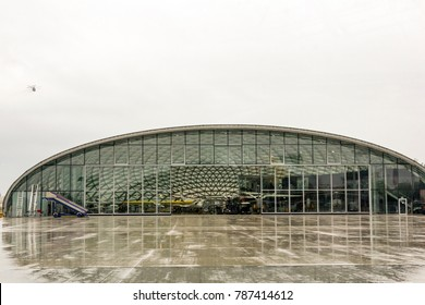 Salzburg, Austria - CIRCA 2017: Red Bull Hangar-7 on a rainy day in Salzburg, Austria. Hangar-7 hosting a collection of historical airplanes, helicopters and Formula One racing cars.