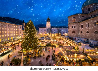 Salzburg, Austria, circa December, 2016: Tourists visiting a traditional Christmas market in front of Salzburg Cathedral at the Residenzplatz