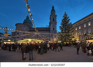 SALZBURG, AUSTRIA - DECEMBER 11, 2017: Christmas market at Residenzplatz square close to Salzburg Cathedral in twilight. The origins of the Salzburg Christmas market go back to the late 15th century.