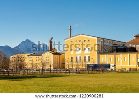 Salzburg, Austria - December 2017: Stigl Brewery Stiegl-Brauwelt factory and museum with truck loading in front