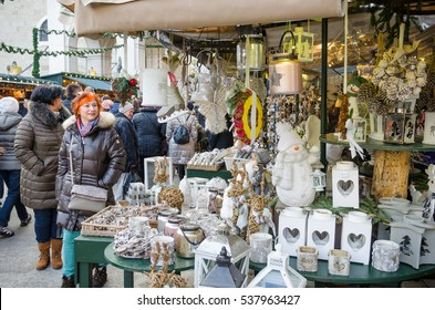 Salzburg, Austria - December 3, 2016: People Walking past a Stall at the Christmas Market in Cathedral Square. Salzburg Christmas market is one of the largest attractions during the Advent season.