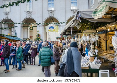 Salzburg, Austria - December 3, 2016: People Strolling around the Christmas Market in Cathedral Square. The historic Salzburg Christmas Market has been held since the end of the 15th century.
