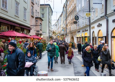 Salzburg, Austria - December 3, 2016: Getreidegasse packed with People Shopping on a Cloudy Winter Day. Getreidegasse is a busy shopping street in the Altstadt  (Old Town) section of Salzburg.