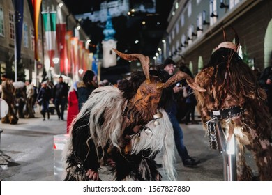 Salzburg, Austria - December 5th 2018: Krampus night parade. People in scary fur costumes and masks with hornes walk on the street. Traditional show before Christmas.
