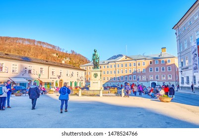SALZBURG, AUSTRIA - FEBRUARY 27, 2019: The Mozart Memorial in the middle of Mozart Square is a famous landmark in old town, the popular meeting place among local youth, on February 27 in Salzburg