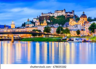 Salzburg, Austria. Festung Hohensalzburg fortress, Salzburger Dom and Salzach river at twilight.