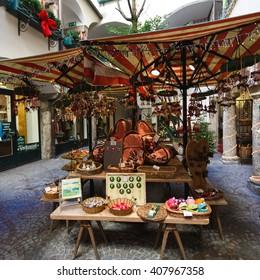 Salzburg, Austria - January 07 2016: Christmas fair in a narrow street of city