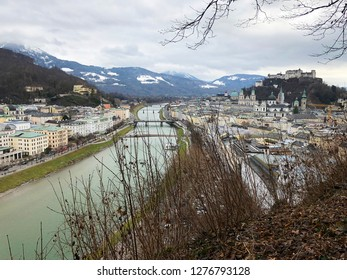 Salzburg, Austria - January 1, 2019: View of the historic city of Salzburg with Salzburg Cathedral and famous Hohensalzburg Fortress in Christmas time in winter.