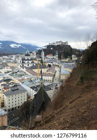 Salzburg, Austria - January 1, 2019: View of the historic city of Salzburg with Salzburg Cathedral and famous Festung Hohensalzburg in Christmas time in winter.
