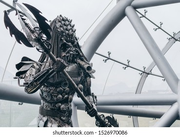 Salzburg / Austria January 19, 2019: Predator industrial sculpture on the background of the construction of glass and steel in Red Bull Hangar 7 Museum in Salzburg.