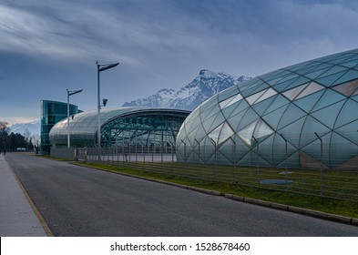 Salzburg / Austria January 19, 2019: The road near by the contemporary glass buildings of Red Bull Hangar 7 Museum and hangar in Salzburg.