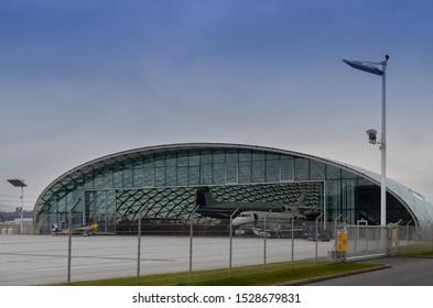 Salzburg / Austria January 19, 2019: Red Bull Team airplanes in the contemporary hangar of Red Bull Hangar 7 Museum in Salzburg airport.