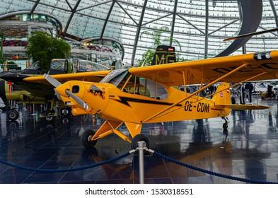 Salzburg / Austria January 19, 2019: Piper PA-18-150 Super Cub airplane exhibited in Red Bull Hangar 7 Museum in Salzburg.