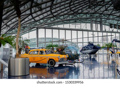 Salzburg / Austria January 19, 2019: A 1963 Checker Cab yellow taxi exhibited on the background of helicopters in Red Bull Hangar 7 Museum in Salzburg.