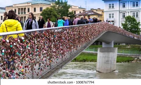 SALZBURG, AUSTRIA - JULY 15, 2017: Love locks on Makartsteg bridge over the Salzach River