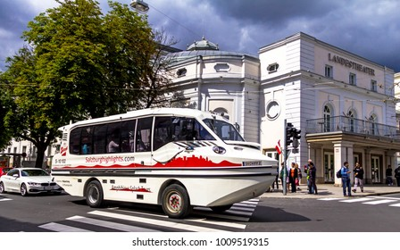 Salzburg, Austria - July 15, 2017: Amphibian car near State Theater ( Salzburger Landestheater), home to Opera, Theatre, Dance and Theatre for Young Audiences, at cloudy summer day