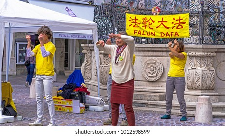 Salzburg, Austria - July 15, 2017: Unidentified Falun Dafa members demonstrate traditional chinese gymnastics combined with elements of Buddhism.