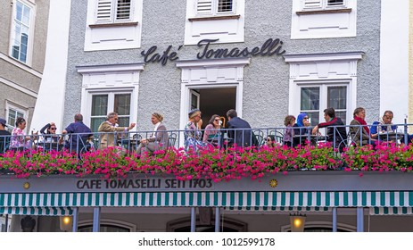 Salzburg, Austria - July 15, 2017: Visitors in the famous cafe Tomaselli at old town