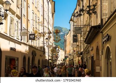 "SALZBURG, AUSTRIA - June 03, 2019: View into famous shopping street ""Getreidegasse"""