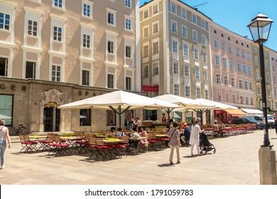 "SALZBURG, AUSTRIA - June 03, 2019: View into famous shopping street ""Goldgasse"""