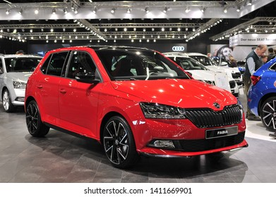 Salzburg, Austria . March 24 , 2019 : metallic red Skoda FABIA atat the at the Automesse Salzburg , Third generation facelift, Typ NJ, MK3, supermini car produced by Czech automobile manufacturer