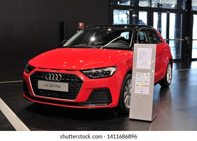 Salzburg, Austria . March 24 , 2019 : metallic red new Audi A1 Sportback Sport 30 TFSI car presented at the at the Automesse Salzburg 2019 , car produced by Audi AG