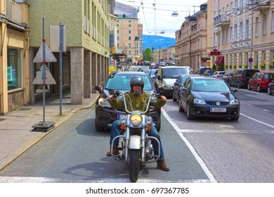 Salzburg, Austria - May 01, 2017: Biker on the street in Salzburg