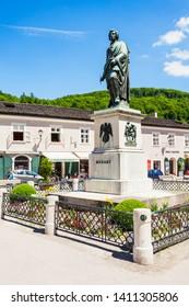 SALZBURG, AUSTRIA - MAY 19, 2017: Mozart monument statue at the Mozartplatz square in Salzburg, Austria. Wolfgang Amadeus Mozart was influential austrian composer of classical era.
