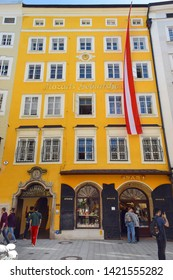 Salzburg, Austria - May 23, 2019 : tourists in front of Wofgang Amadeus Mozart's Birthplace house at Getreidegasse 9 on a popular shopping street in the old town