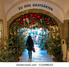 Salzburg / Austria - Nov. 24, 2017: Woman Enters Salzburg Christmas Market for Christmas Shopping
