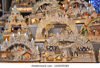 SALZBURG, AUSTRIA - NOVEMBER 25, 2017: Christmas handcrafted wooden houses and native scenes on traditional Christmas market stall in Salzburg, Austria.